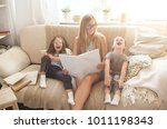 happy family reading books... | Shutterstock . vector #1011198343
