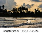 a surfer with his surfboard in... | Shutterstock . vector #1011210223