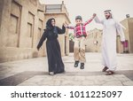arabic family playing with child | Shutterstock . vector #1011225097