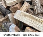 firewood background   chopped... | Shutterstock . vector #1011239563