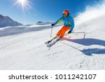 skier skiing downhill during... | Shutterstock . vector #1011242107