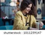 beautiful teenager sitting in a ... | Shutterstock . vector #1011259147