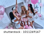 pajama party. top view of four... | Shutterstock . vector #1011269167