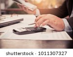 a businessman analyzing... | Shutterstock . vector #1011307327