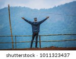 young in the mountains.the... | Shutterstock . vector #1011323437