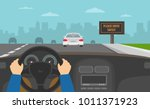 hands driving a car on the... | Shutterstock .eps vector #1011371923