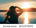 happy hopeful woman looking at... | Shutterstock . vector #1011373993