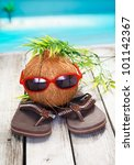 Small photo of Humorous spoof of a cool coconut adventurer with a leafy hairstyle and trendy red sunglasses