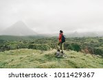 hiker young woman with backpack ...   Shutterstock . vector #1011429367