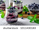 chia pudding with blueberry and ... | Shutterstock . vector #1011430183