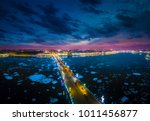 Russia is the beginning of winter in St. Petersburg. Ice drift on the Neva River. Bridges of Petersburg. Trinity Bridge over the Neva River. Evening view of the city of St. Petersburg.