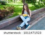 cute teenage girl reading book... | Shutterstock . vector #1011471523