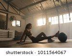 sportswoman doing leg... | Shutterstock . vector #1011564067