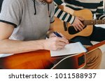 learning to play the guitar.... | Shutterstock . vector #1011588937