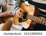 learning to play the guitar.... | Shutterstock . vector #1011589003
