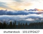 mountain tops in the snow ... | Shutterstock . vector #1011592627