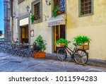 Narrow Street With Tables Of...