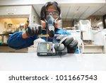 instrument technician is take... | Shutterstock . vector #1011667543
