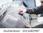 car wrapping specialist putting ...   Shutterstock . vector #1011682987