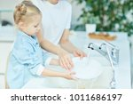 little girl helping her mother... | Shutterstock . vector #1011686197