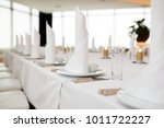 dinner set arranged on a table... | Shutterstock . vector #1011722227