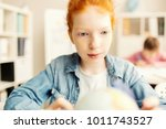 adorable pupil looking at... | Shutterstock . vector #1011743527