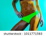 woman's wet abdomen.attractive... | Shutterstock . vector #1011771583
