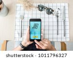 woman pay food via mobile apps...   Shutterstock . vector #1011796327