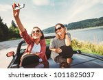 two female freinds take a... | Shutterstock . vector #1011825037