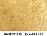 gold shiny foil background ... | Shutterstock . vector #1011856033
