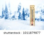 thermometer in winter weather.... | Shutterstock . vector #1011879877