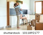 portrait of young couple moving ... | Shutterstock . vector #1011892177