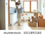 portrait of young couple moving ... | Shutterstock . vector #1011892183