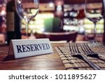 restaurant reserved table sign... | Shutterstock . vector #1011895627
