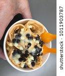 a bowl of rolled frozen fried... | Shutterstock . vector #1011903787