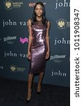 Small photo of New York, NY - January 27, 2018: Afiya Bennett wearing dress by Tom Ford attends John Varvatos SS18 ad campaign launch party at The Angel Orensanz Foundation