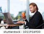 businessman having a coffee... | Shutterstock . vector #1011916933