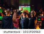 friends watches football on tv... | Shutterstock . vector #1011920563