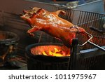 barbecued suckling pig fire... | Shutterstock . vector #1011975967