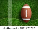 american football ball on green ... | Shutterstock . vector #1011995707