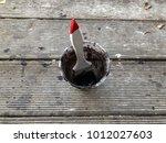 the black paint brush in... | Shutterstock . vector #1012027603