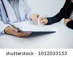 doctor handed pen to patients... | Shutterstock . vector #1012033153