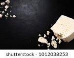 greece feta cheese on dark... | Shutterstock . vector #1012038253