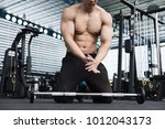 young muscular man clap hand in ... | Shutterstock . vector #1012043173