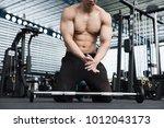 young muscular man clap hand in ... | Shutterstock . vector #1012043173
