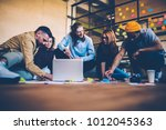 group of designers making... | Shutterstock . vector #1012045363