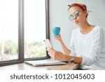 shot of funny female model... | Shutterstock . vector #1012045603
