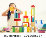 little girl in a colorful shirt ... | Shutterstock . vector #1012056397