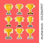 golden winner cups collection... | Shutterstock .eps vector #1012063957