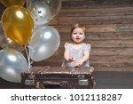 the little girl sits near a big ...   Shutterstock . vector #1012118287